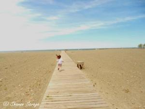 Naomi Running on Boardwalk
